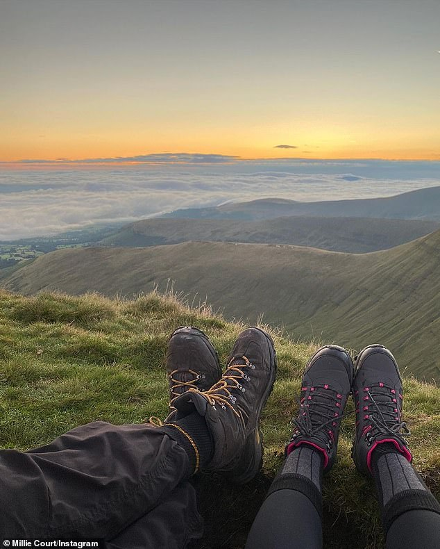 Exercise: The loved-up pair shared another snap of their walking boots as they looked out over the view