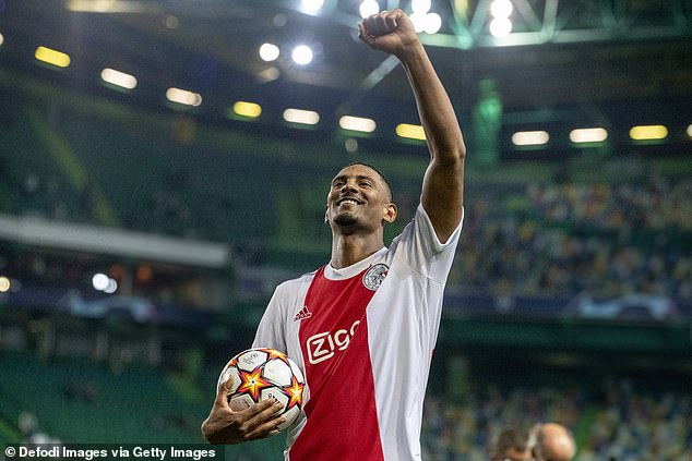 Sebastien Haller salutes the Ajax fans and takes home the matchball after his four goal spree