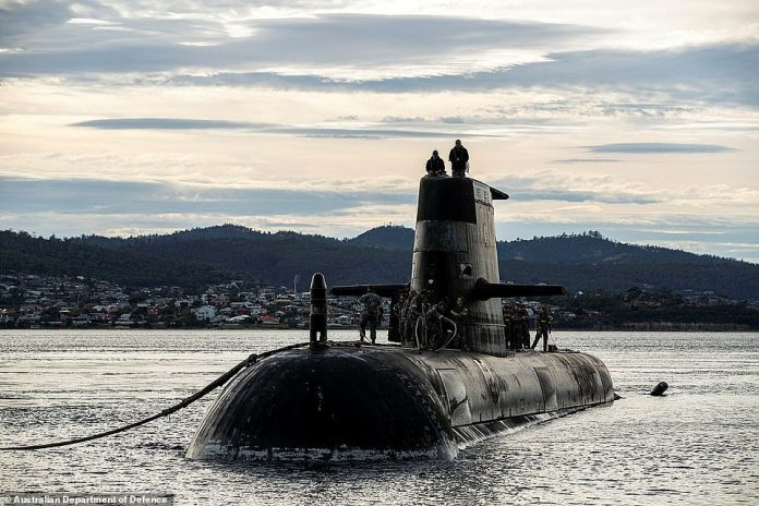 The deal will mean Australia will walk away from its controversial deal to spend up to $90billion buying French diesel-powered submarines.Pictured: The Collins-class Sheean in Tasmania in April