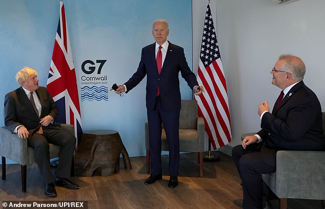 Now Macron finds his country not only billions of pounds short – but also locked out of a key initiative by Western powers to build a bulwark against China. Above: US President Joe Biden with Boris Johnson (left) and Australian Prime Minister Scott Morrison