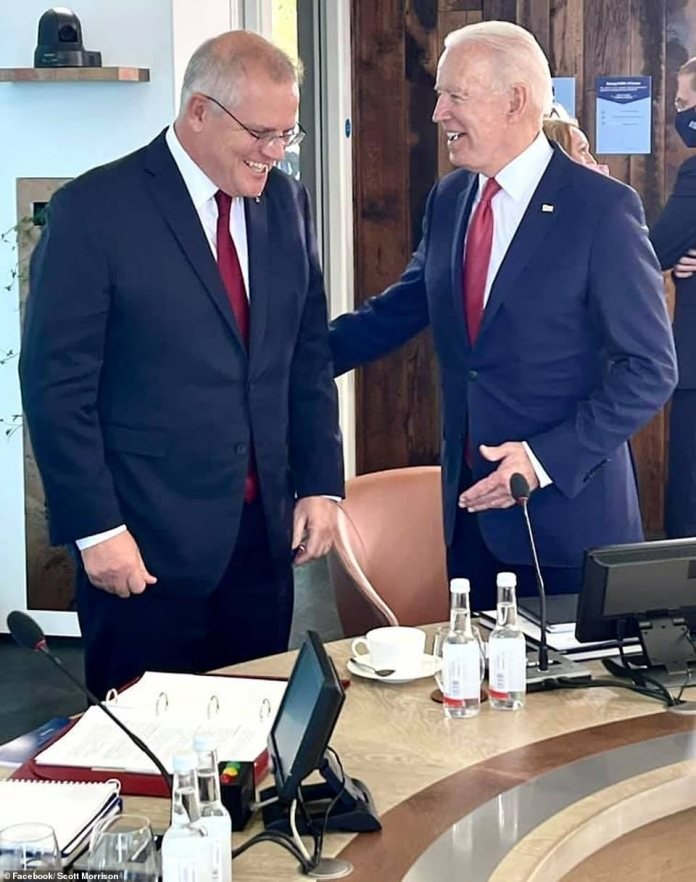 Scott Morrison and Joe Biden are seen together at the G7 summit in Cornwall in June (pictured) when the deal was secretly being hatched