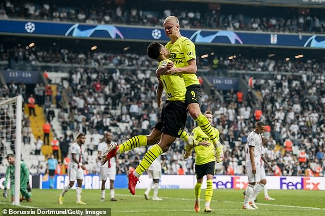 Bellingham celebrates with Erling Haaland after the duo combined to score at Besiktas, with both players being targeted for moves next summer by Europe's elite clubs