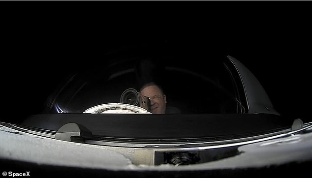 Aboard the Crew Dragon capsule, the crew will orbit the Earth about 15 times a day during their three-day journey.  Pictured is Chris Sambrowski