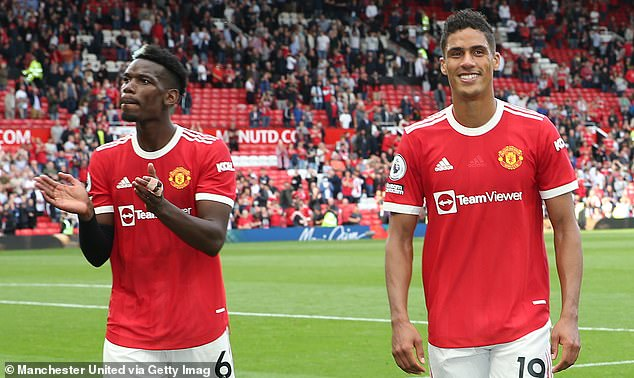 The centre back links up with international team-mate Paul Pogba (left) at Old Trafford