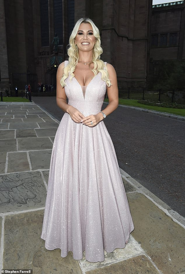 Wow!  Christine McGuinness, 33, put on a show-stopping display in a pink sequined ballgown as she arrived for The National Diversity Awards in Liverpool on Friday.