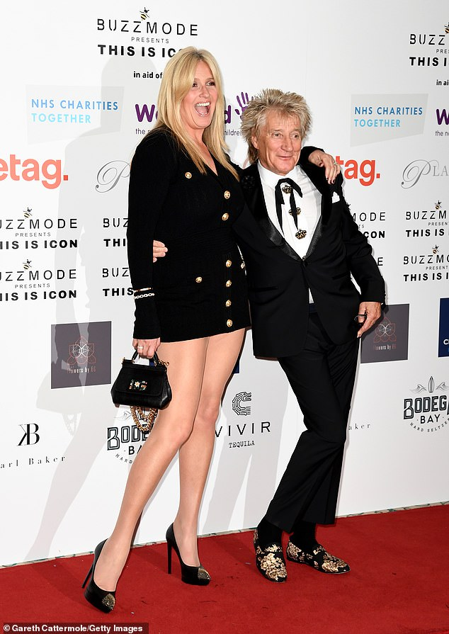 Proud: The legendary singer proudly shook hands with the former model at The Landmark Hotel in London as she rocked a stunning performance in a black blazer dress