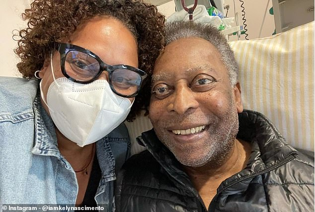 His daughter Kelly Nascimento (left) posted a photo of him smiling in a hospital bed with Pele