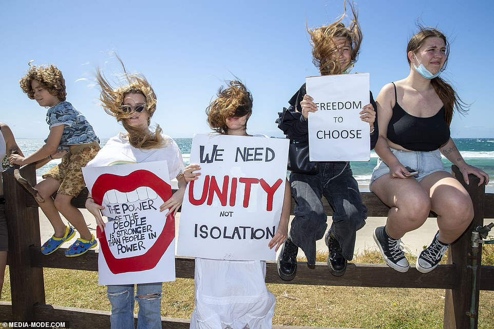 Locals were spotted holding a number of anti-lockdown signs - despite Byron Bay not in current lockdown