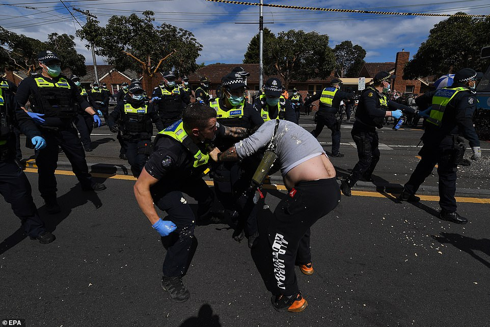 The scenes were a lot more violent in Melbourne on Saturday from 12pm, where locals clashed with police (pictured)