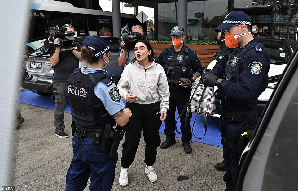 Tensions were also high in Sydney, with two protest marches (pictured, a woman chats to police at Bass Hill on Saturday)