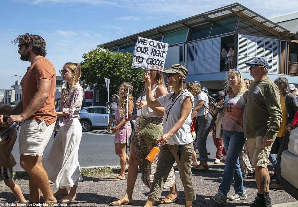Other signs locals from Byron Bay who took part in Saturday's anti-lockdown march read 'We claim our right to choose'