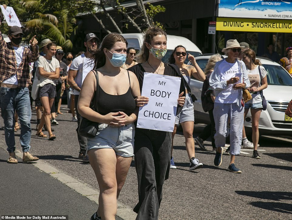 Other anti-vaxxers were spotted in Byron Bay clutching signs which read 'My Body My Choice' on Saturday