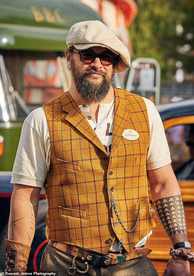 Hollywood star: Jason Momoa, 42, (pictured) put on his best as he celebrated British motor racing at the historic Goodwood Revival Festival in West Sussex, England, on Saturday.