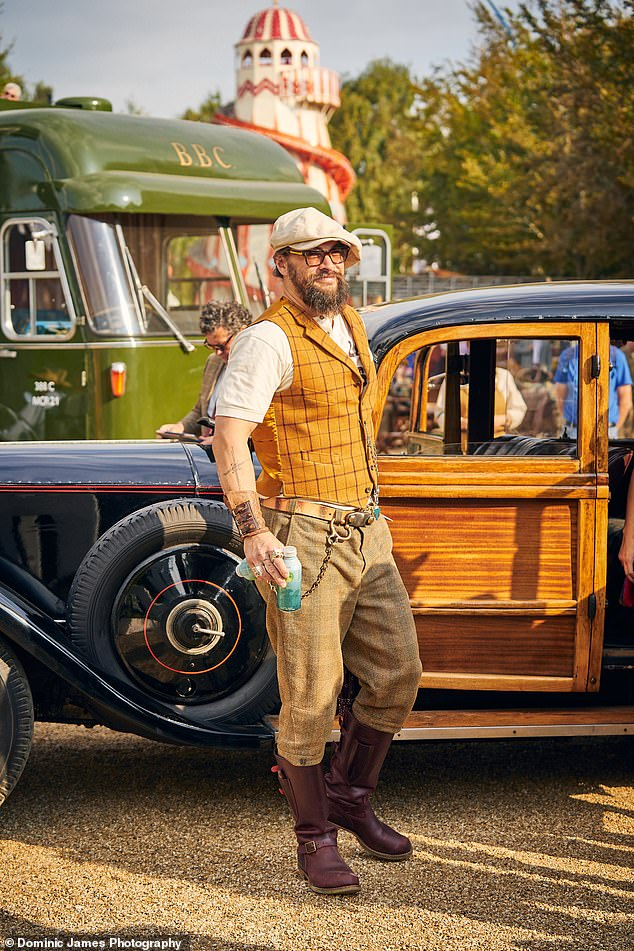Period Costume: Posing in front of an old-fashioned car, Aquaman fame Jason wore a beige top with a mustard-colored plaid vest, mismatched trousers, and brown riding boots.