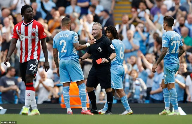 The Manchester City full-back tries to defend his case after he was shown the red card mid-way into the second-half