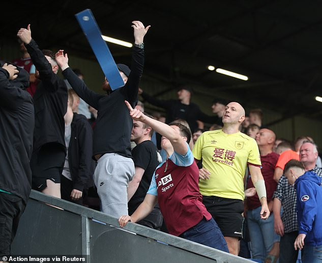 Burnley fans smashed parts of wooden seats and threw them at Arsenal fans