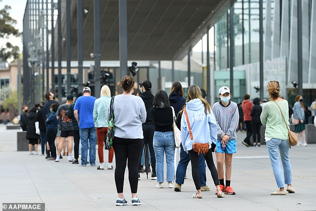 Victoria recorded 507 new Covid-19 cases and one death on Sunday as Premier Dan Andrews is set to unveil his roadmap out of lockdown (pictured, people waiting in line at a vaccination clinic in Melbourne on Friday)