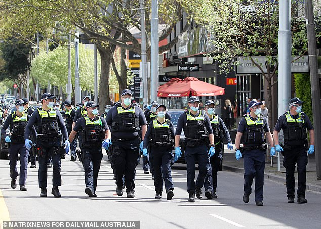 Dan Andrews is expected to announce what life will look like for locked-down Victorians for the rest of the year on Sunday, one 70 per cent of the population is double vaccinated (pictured, police presence at an anti-lockdown protest in Melbourne on Saturday)