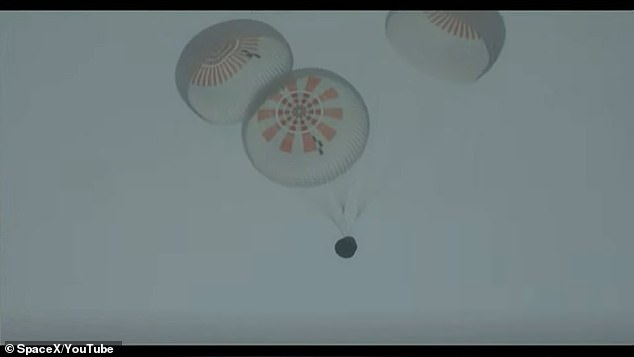 Four main chutes open as Inspiration 4 capsule lands back on Earth after a three-day mission in space