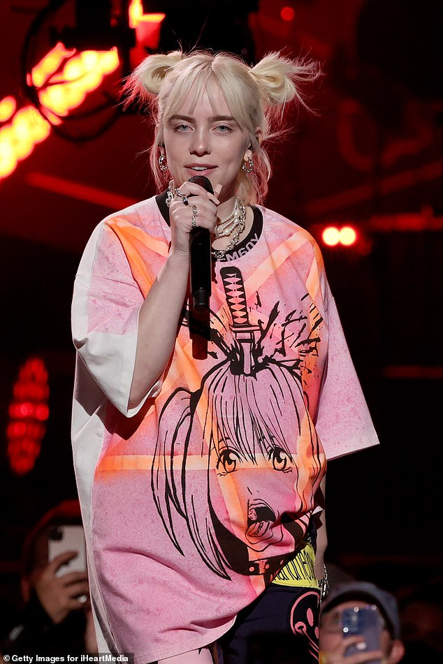 Singing sensation: Billie Eilish, 19, donned her baggy clothes while taking the stage at the 2021 iHeartRadio Music Festival in Las Vegas on Saturday night