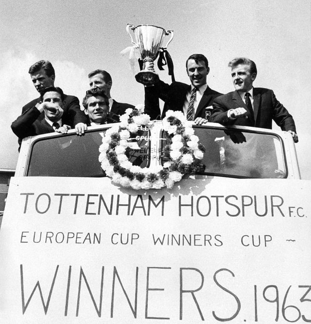Greaves (2nd right) got his hands on the European Cup Winners' Cup in 1963 after scoring in the final against Atletico Madrid