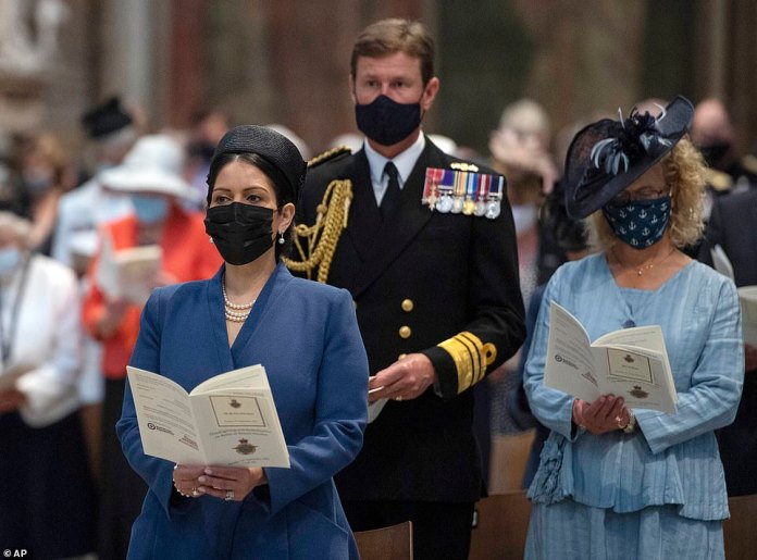 The Home Secretary photographed while in service;  Guests were seated in a socially distant bubble to ensure the ceremony could proceed safely