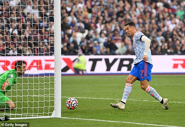 Cristiano Ronaldo pokes home after being saved by Lukasz Fabianski after his opening attempt
