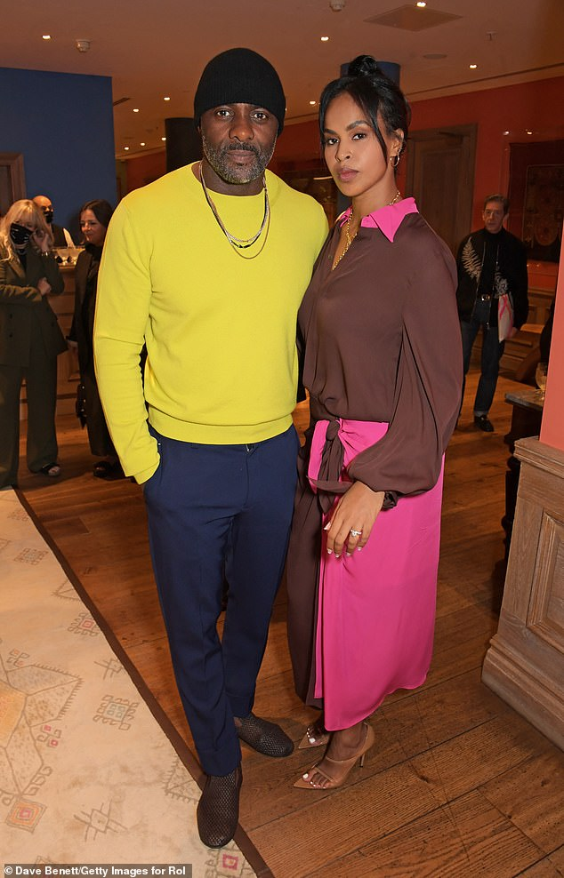 Wow! Idris Elba, 49, showed off his athletic figure at the Roland Mouret presents Terma by Magaajyia Silberfeld event alongside his stunning wife Sabrina, 32