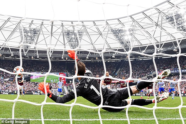 Manchester United's David de Gea plunged to his left to save Noble's stoppage-time spot-kick
