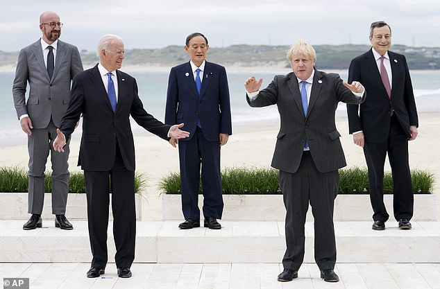 Boris Johnson will look to mend fences with US President Joe Biden during his visit to a White House. Pictured:Leaders of the G7 pose during a group photo at the G7 meeting in Cornwall