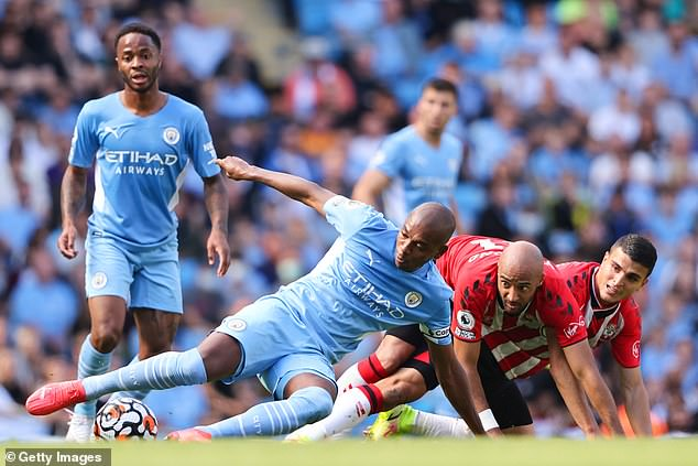 City manager Guardiola publicly criticised the back four and captain Fernandinho (centre)