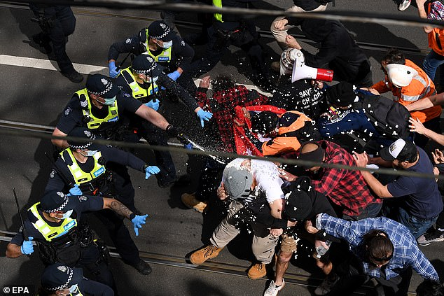 Hundreds of anti-lockdown demonstrators took to the streets in Melbourne on Saturday, sparking violent confrontations with police