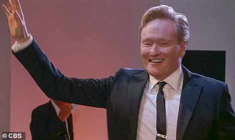 Before and after: Conan O'Brien got up to salute before the award for Variety Talk Series was announced