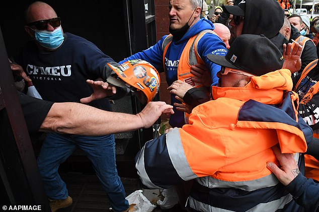 Hundreds of workers in h-vis vests gathered outside the CFMEU head office on Elizabeth St on Monday morning