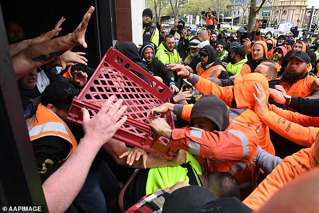 A bread crate was one of the projectiles hurled during wild scenes outside CFMEU headquarters in Melbourne