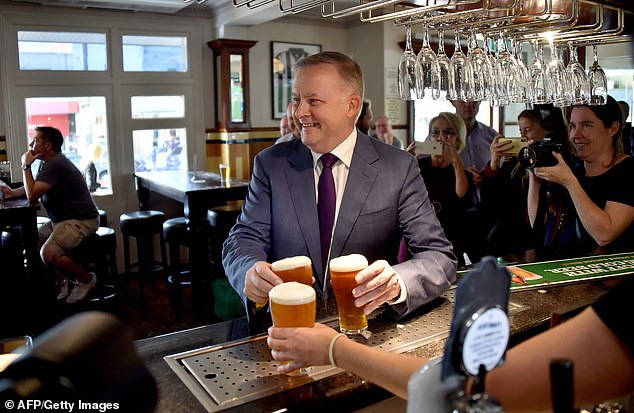 Mr Albanese gave up beer and wine for three months to slim down. Before this year he was often pictured drinking craft beer. He is pictured at a Sydney pub in May 2019