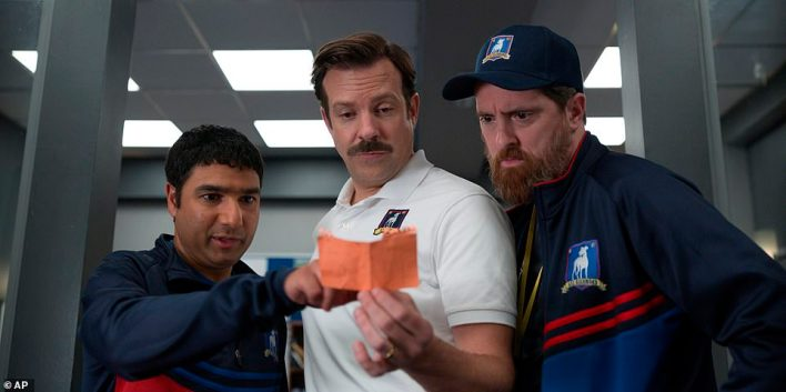 Leadership: Ted manages to inspire his team, despite having trouble coaching them to a win; pictured with Nick Mohammed (L) and Brendan Hunt (R)
