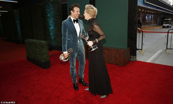 Heart-to-heart: Smart left Sudeikis grinning ear-to-ear as they had a chat in the winners' room after both scoring Emmys