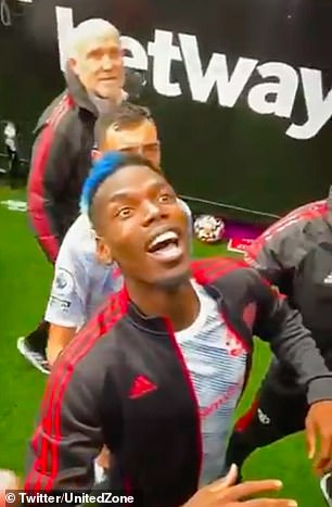 Paul Pogba can be seen reacting to abuse from West Ham fans