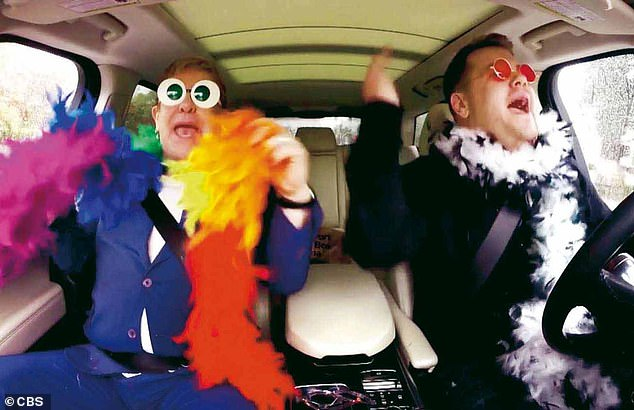 Previous studies have noted that loud, lyrical music can increase hyperactivity and aggression levels, as well as encourage overconfidence, especially among young drivers.  Image: Elton John (left) and James Corden (right) use fun boos and fun glasses for a 'Carpool Karaoke' session on 'The Late Late Show' - but could that behavior put them at risk?