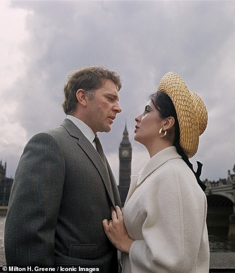 Dressed in a cream wool coat and a straw boater hat and hoop earrings, the star drags her soon-to-be husband