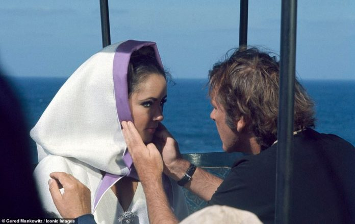 Photographer Gered Mankovitz recalls traveling to Sardinia to shoot the star, when she was on location for the 1968 film.  She is seen wearing a white silk cloak with a purple satin trim
