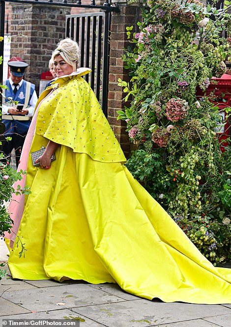 The reality star appeared in high spirits as she entered the event wearing a vibrant yellow gown