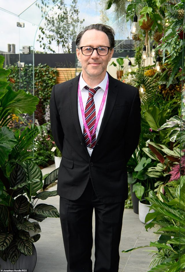 Actor and writer Reece Shearsmith looked smart in a black suit, crips white shirt and red and black tie as he stayed in the Dobbies garden