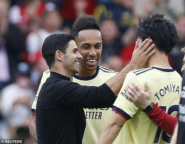 Mikel Arteta (left) is in the bottom half of the Gunners table after a slow start