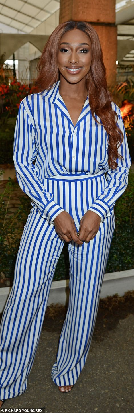 Singer Alexander Burke stunned in a striped white and blue co-ord suit at the Italian Piazza, Villagio Verde Garden