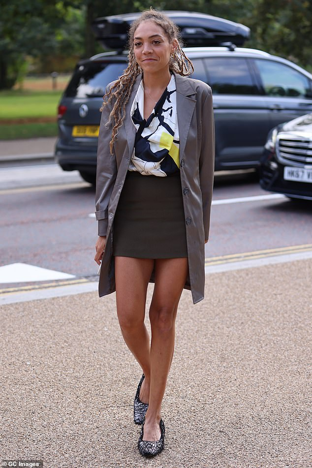 Dress: The 37-year-old TV presenter wore a navy blouse with white and yellow prints that she paired with a khaki skirt