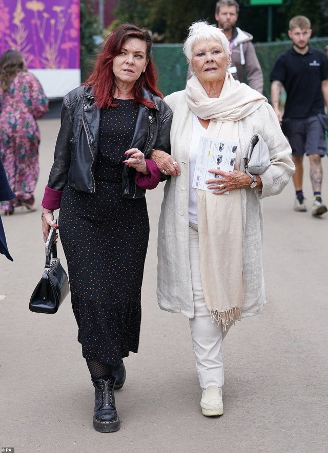 Dame Judi Dench and her daughter walked arm in arm as they toured the different displays of the show today, pictured