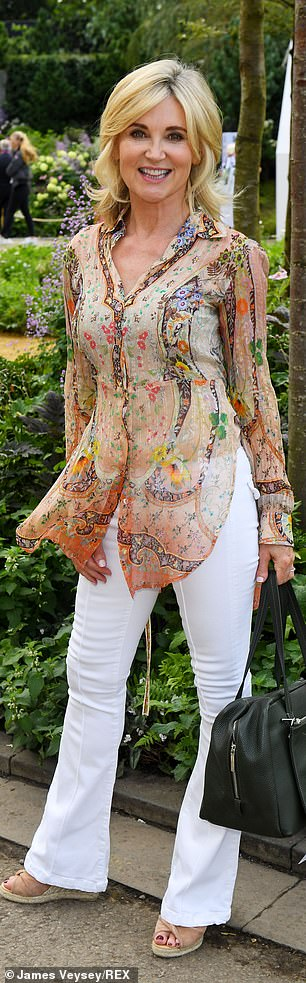 The TV presenter 60, looked charmingly cute in a floral inspired sheer chiffon blouse and opted to pair the look with crisp white flared trousers.