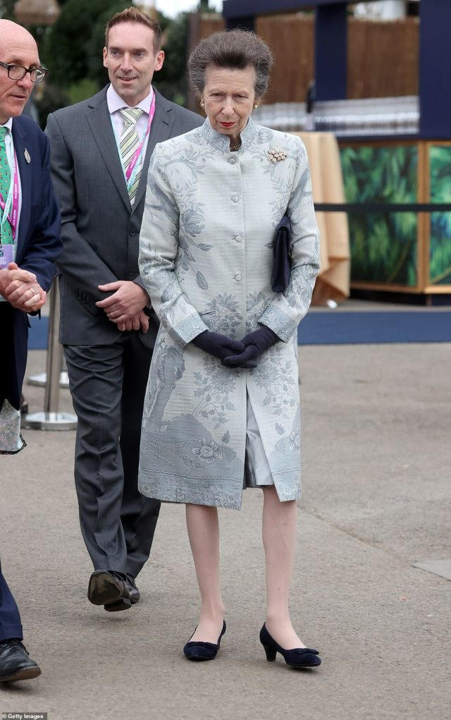 Meanwhile, her sister in law Anne opted for a blue-grey look sporting a button down coat with navy heels, gloves and bag